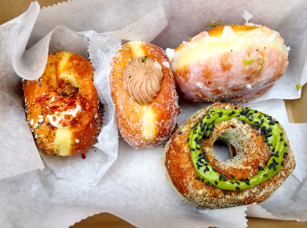 Everything Bagel Doughnut Filled with Cream Cheese and Bacon, Chocolate Cream Filled Doughnut, Glazed Doughnut, and Matcha Green Tea Doughssant